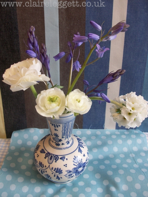 Claire_leggett_Ranunculus and Bluebells_set up